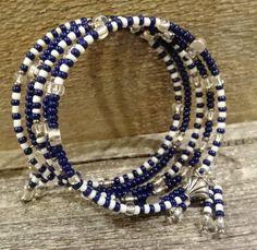 Crisp Navy and white glass beaded bracelet with tassels....LOVE <3 by FusedbyGenet on Etsy