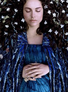 """Padme Amidala's """"water gown"""". This is Episode III, during her funeral. She's wearing the charm of the necklace Anakin gave her! It's on her ring."""
