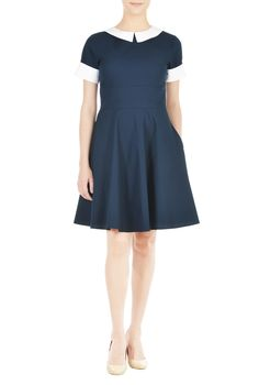 Our polished fit-and-flare dress in contemporary cotton poplin gets an air of vintage glamour and chic sophistication from a contrast Peter Pan collar and rolled cuffs.