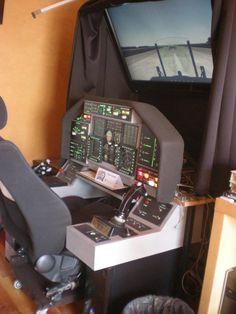 """Sebas Velasco  Ademas de los componentes de Opencockpits,tiene los joysticks HOTAS Cougar , los pedales Elite rudder y los marcos para MFD de Thrustmaster. La pantalla es una TV de plasma de 42""""."""