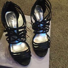 Strappy platform heel. Zipper back black snake skin small platform heel. Delicious Shoes Heels