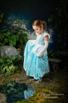 cinderella looking at dress in water princess photography