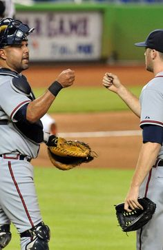 Gearld Laird #11 of the Atlanta Braves celebrates with Alex Wood #58 of the Atlanta Braves after defeating the Miami Marlins 7-1 in the fourteen innings of a baseball game