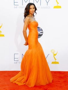 Top Chef's Padma Lakshmi steals everyone's thunder in a show-stopping tangerine Monique Lhuillier confection.