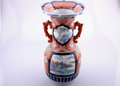 Description: A Chinese porcelain baluster, vase the vessel decorated in typical japanese imari colours of rouge de fer, orange, gold and dark blue glazes with lanscapes in other colours . Chinese 19/20thc  item's measurements: Height: 28,5 cm Width / Diameter: 16 cm  Item Date: 19/20thc