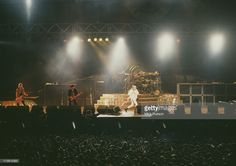 American rock group Guns N' Roses performing on stage at the at the Maracana stadium during the Rock in Rio II festival, Rio de Janeiro, Brazil, 18th- 27th January 1991. Left to right: Duff McKagan, Izzy Stradlin and Axl Rose.