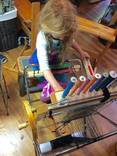 CENTERING WITH FIBER: Hand Spinning textured yarns , The Saori Piccolo loom and a new Bobbin holder rack for weaving shuttle bobbins