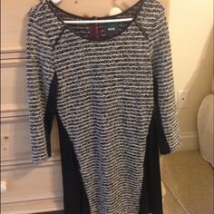 Anthropologie black and white dress Never been worn. Chiffon like material in the back with button detailing at the top. Faux leather lining around neck Anthropologie Dresses