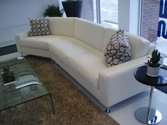 Master Sofa with 45 degree turn. Available in your choice of leather or fabric. Made in Canada by Selene Furniture.