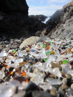 Glass Beach in Fort Bragg. Over several decades, the pounding waves cleaned the beach that early 20th century residents had used as a dump, by breaking down everything but glass & pottery & tumbling those into small, smooth, colored pieces. The pretty and refurbished  beach is now a tourist attraction.