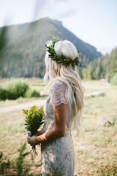Outdoor summer weddings call for lush greenery! Create a halo from verdant ferns and carry a bouquet of young wildflowers to tie in nature's beauty. -BHLDN Stylists
