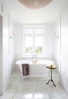 white pedestal bathtub | ps design studio