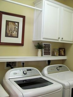 Shelf above washer/dryer-- also really like where they put a hanging bar! I could totally do this