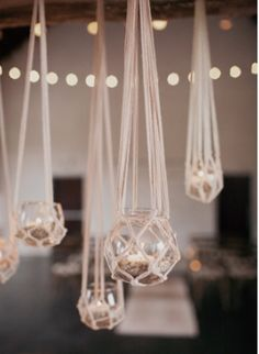 candle holders in macrame hangers Hanging Centerpiece, Hanging Candles, Centerpiece Ideas, Macrame Chairs, Macrame Plant Hangers, Craft Markets, Mason Jar Candles, Wedding Event Planner, Natural Home Decor