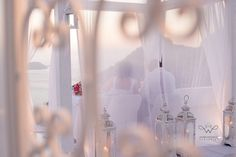 The dana villas curtain canopy arranged for private dining for Natali and William's wedding day in Santorini