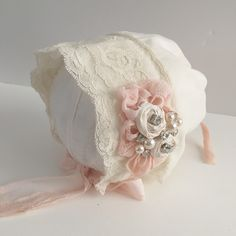 Newborn size bonnet with lace detail and handmade rosettes Please allow up to 10 days for this item to ship as it is made to order