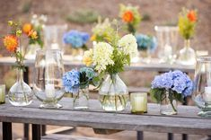 Glass Vases of Flowers    Photography: Elisabeth Millay Photography   Read More:  http://www.insideweddings.com/weddings/fourth-of-july-pre-wedding-party-in-central-california-countryside/655/