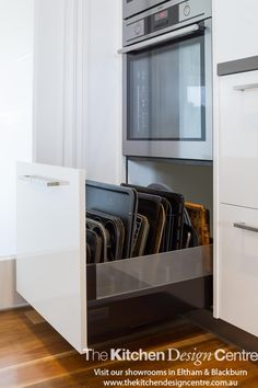 A modern, sleek, family kitchen designed with lots of storage and functionality and a large butler's pantry. www.thekitchendesigncentre.com.au @thekitchen_designcentre