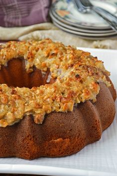 An intensely moist and sweet gluten free pineapple coconut bundt cake topped with a broiled brown sugar, coconut, and macadamia frosting for the perfect crunch.