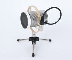 """Most DIY enthusiasts who are interested in audio gear are familiar with the standard """"tin can mic"""" (or variations thereof), in which a piezo disc is taped onto the bottom of a tin can and then plugged into a high impedance voltage amplifier, like a guitar amp. These types of microphones are nice because they are so easy to make, but they are quite limited in most other areas, including bandwidth, microphonics, signal to noise ratio, impedance matching, and cable driving. These is..."""