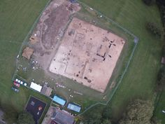 An aerial view of the excavations at Lyminge in southeastern England taken at the end of the 2012 field season shows the outlines of a large rectangular royal feasting hall dating to about A.D. 600.