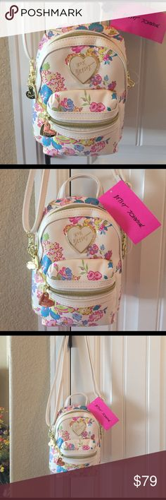 """TODAY BETSEY JOHNSON FLORAL BACKPACK/CROSS BODY BRAND NEW! AUTHENTIC BETSEY JOHNSON FLORAL BACKPACK/CROSS BODY-Approximate Measurements-8"""" X 6"""" X 2"""", with a convo adjustable strap....NEVER USED!! EXCELLENT NEW CONDITION!! Betsey Johnson Bags Backpacks"""