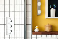 bathroom - white tiles, Ikea lighting, iroko shelf and yellow wall White Bathroom Tiles, Yellow Bathrooms, White Tiles, Ikea Yellow, Yellow Walls, Ikea Lighting, Party Stores, Magazine Design, Shelves