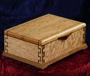 Lidded box with inlaid dovetails