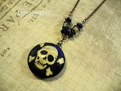 The Jolly Roger black & white polymer clay pendant by LynzCraftz