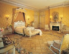 Master Bedroom - Mr. and Mrs. Flagler shared the Master Suite, a practice uncommon at the turn-of-the-century. The suite included two separate dressing chambers, a large bath area, and a bedroom. The bedroom, decorated in the Louis XIV style, is furnished with the original bedroom furniture. The bed fabric and wallcoverings were reproduced based on samples of the original fabric. Henry Morrison Flagler Museum (Palm Beach, Florida)