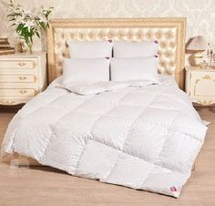 """Blanket quilted """"Deluxe"""" -100 %natural down of white goose."""