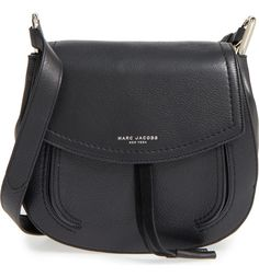 This curvy shoulder bag by Marc Jacobs is done up in supple textured leather and highlighted by signature metallic branding at the flap.
