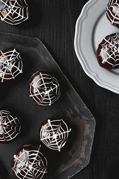 Celebrate Halloween with these Death By Chocolate Doughnuts. Chocolate yeast doughnuts filled with strawberry jam and topped with chocolate ganache & icing.