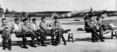 Finnish pilots taking a break, Finland (behind them you can see their Me-109′s) (1943) ""