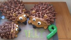 Hedgehog cakes, body shapes baked in bowls, with chocolate buttons and flakes for the spines