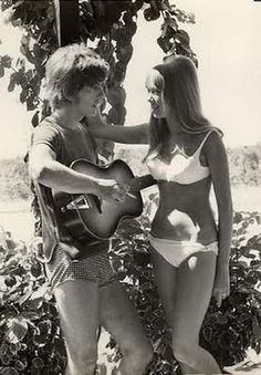 George Harrison serenading Pattie Boyd