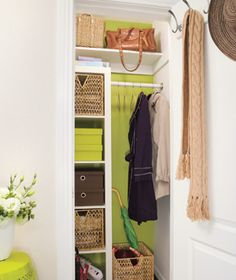 Great system for those small (or hall) closets. (Much like Rita's-I used a hanging organizer instead of built-in shelves, and hung a coat rack on the outside of the door for guest garb.