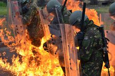 In the Heat of the Moment: British riot troops stand firm against a petrol bomb attack in a street riot in Hampshire, Southern England.