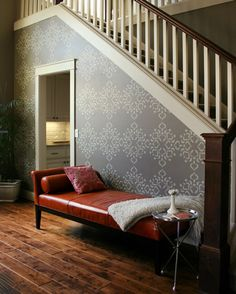 Create a stenciled focal wall - you can get as creative as you want with this project! I love the room use under the stairs also!