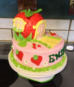 A tiered cake with Strawberry Shortcake's house :)