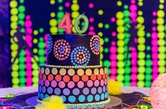What a great cake at a neon glow in the dark birthday party! See more party ideas at CatchMyParty.com!