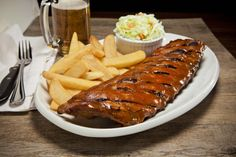 """Baby Back Ribs A full rack of fall-off-the-bone baby back ribs, double glazed with our """"famous"""" homemade BBQ sauce Off The Bone, Homemade Bbq, Ribs, Chicken Wings, Meat, Fall, Autumn, Fall Season, Pork Ribs"""