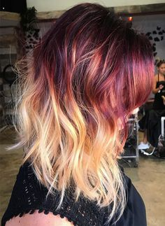 Red warm shades hair color ideas for women to use in fall winter 2017-2018.