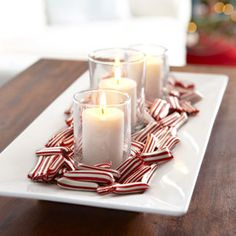 A sleek, simple tray with pillar candles and peppermint puffs is part decoration, part dessert and a less traditional take on the classic candy dish. Read more: Red and White Christmas Decorations - Red Christmas Decorating Ideas - Good Housekeeping Peppermint Christmas Decorations, Christmas Dinner Centerpieces, Easy Christmas Dinner, Noel Christmas, Simple Christmas, White Christmas, Holiday Decorations, Xmas, Diy Centerpieces