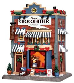 Lemax decorative villages are a holiday tradition made with old-world craftsmanship, combined with new-age technology. Village Lemax, Lemax Christmas Village, Halloween Village, Christmas Town, Christmas Villages, Gingerbread Village, Lego Christmas, Christmas Trees, Christmas Decor