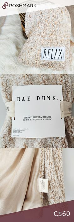 """Brand New Rae Dunn """"Relax"""" sherpa throw blanket Super soft and warm throw blanket by Rae Dunn. It has a soft sherpa fabric on the exterior and a smooth velvet like fabric on the interior. It's a cream color. Brand new with tags. Pair with other Rae Dunn items in my closet! Rae Dunn Bedding Blankets & Throws Baby Santa Outfit, Christmas Hand Towels, White Throw Blanket, Merry And Bright, Blankets, Bedding, Relax, Smooth, Velvet"""