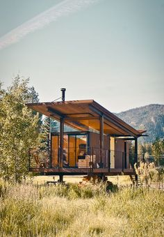 """The steel-clad Rolling Huts designed by Olson Kundig Architects in Manzama, Washington, sit lightly on the land thanks to wheels that allow the tiny residences to """"hover"""" above the site, optimizing views of the landscape."""