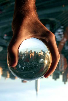 Big hand, little city (could be a fun counterpart to my skyline wineglass painting)