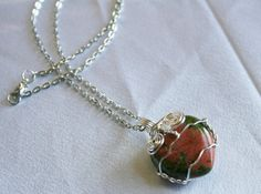 Hey, I found this really awesome Etsy listing at https://www.etsy.com/listing/178905045/unakite-stone-heart-wire-wrapped-pendant