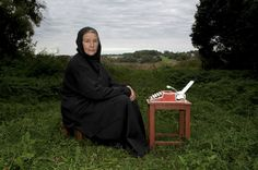 Ivan Zhuk. Mother Fomaida writing religious poems